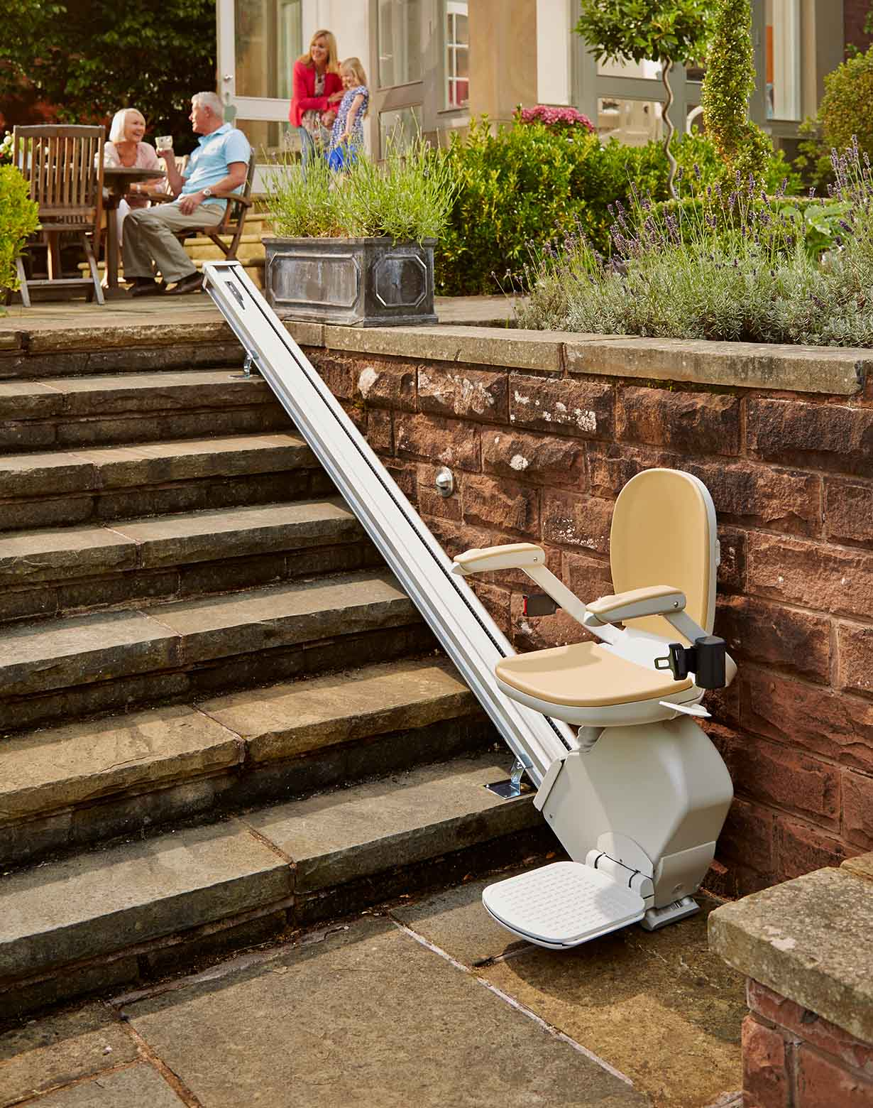 Outdoor straight stairlift to help in the garden on concrete steps